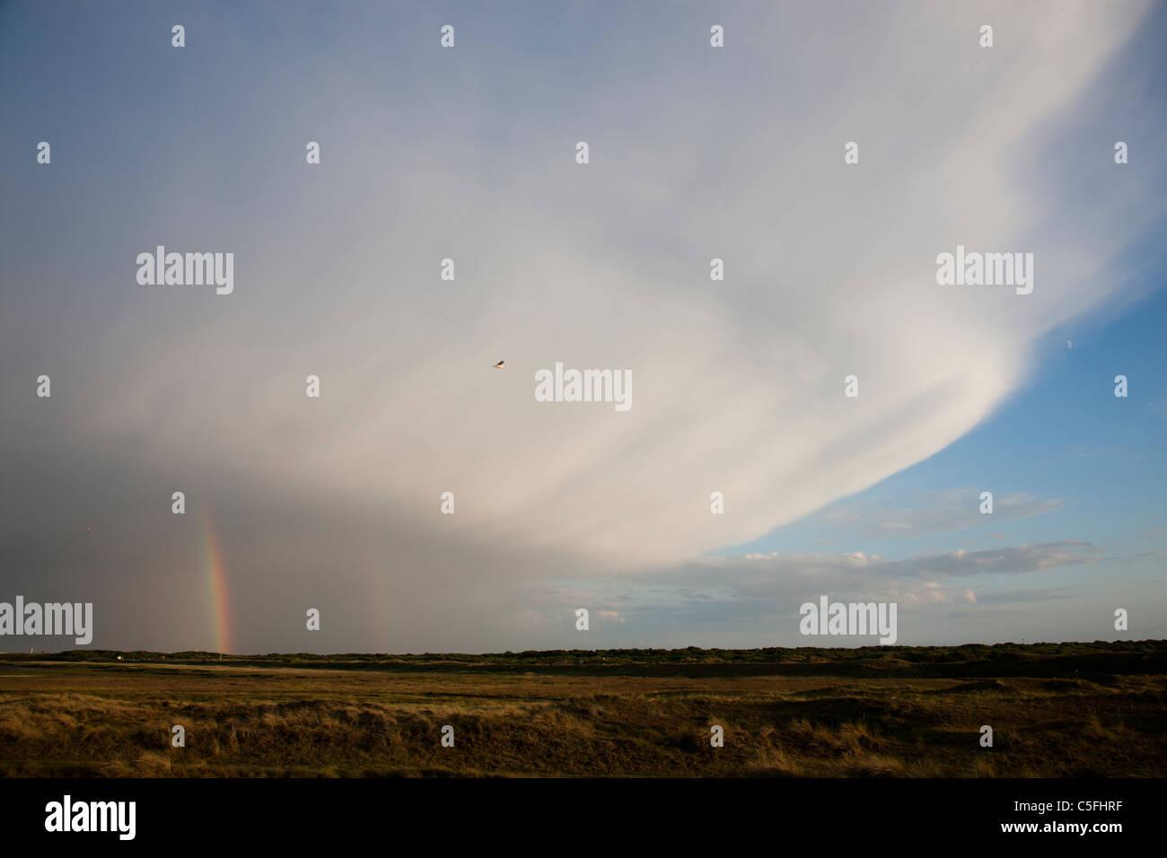 Cumulonimbus with a rainbow - Stock Image