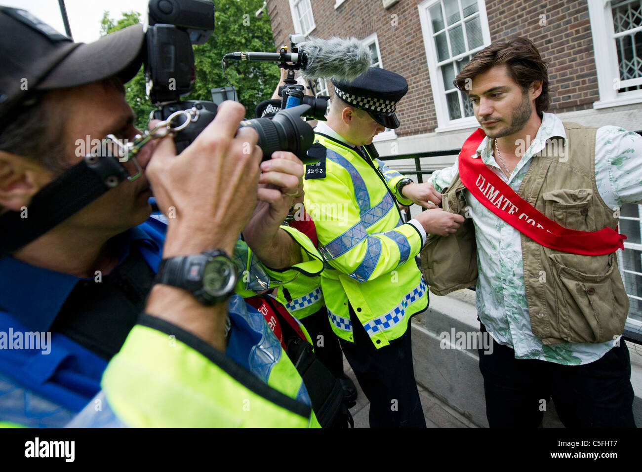 Police search and question a Climate Rush protestor against the 4000 deaths caused by poor air quality in London - Stock Image