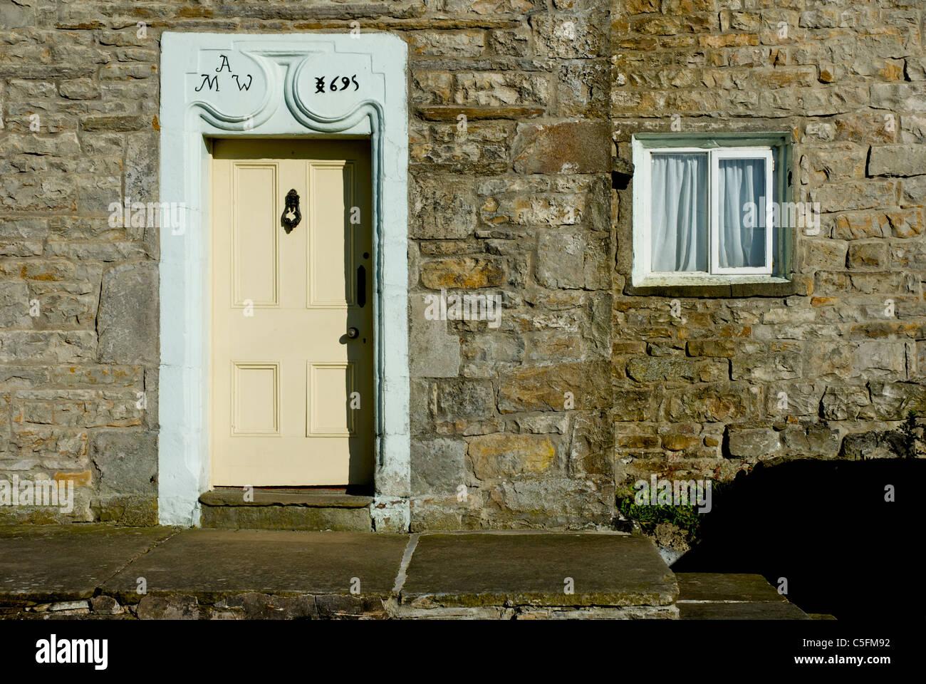 Door of house in village of Gayle, near Hawes, Wensleydale, Yorkshire Dales National Park, England UK - Stock Image