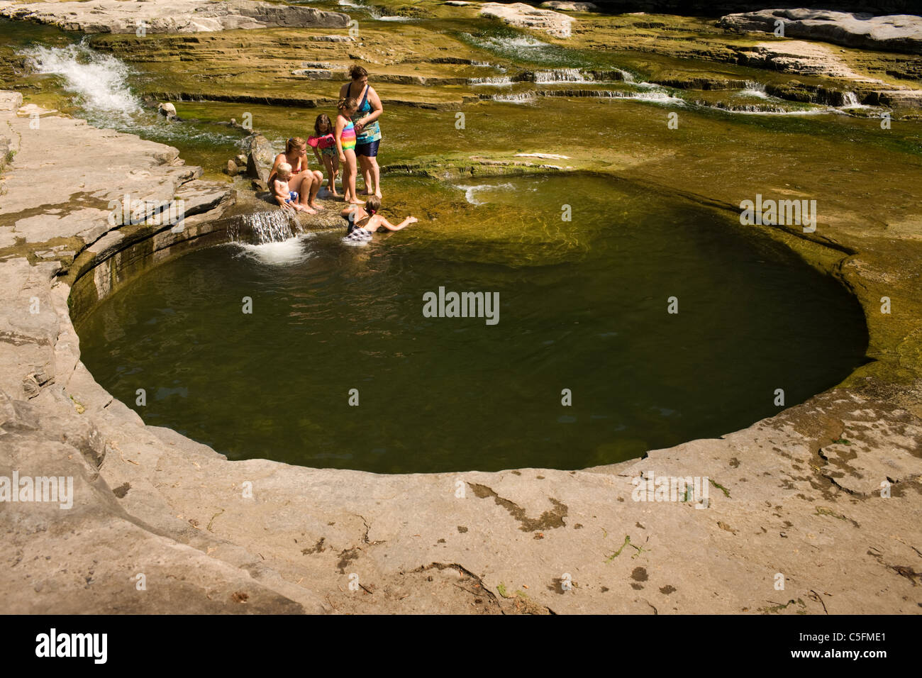 Families and friends swim in the 'Boiling Pot', Canajoharie, MOhawk Valley, Montgomery County, New York - Stock Image