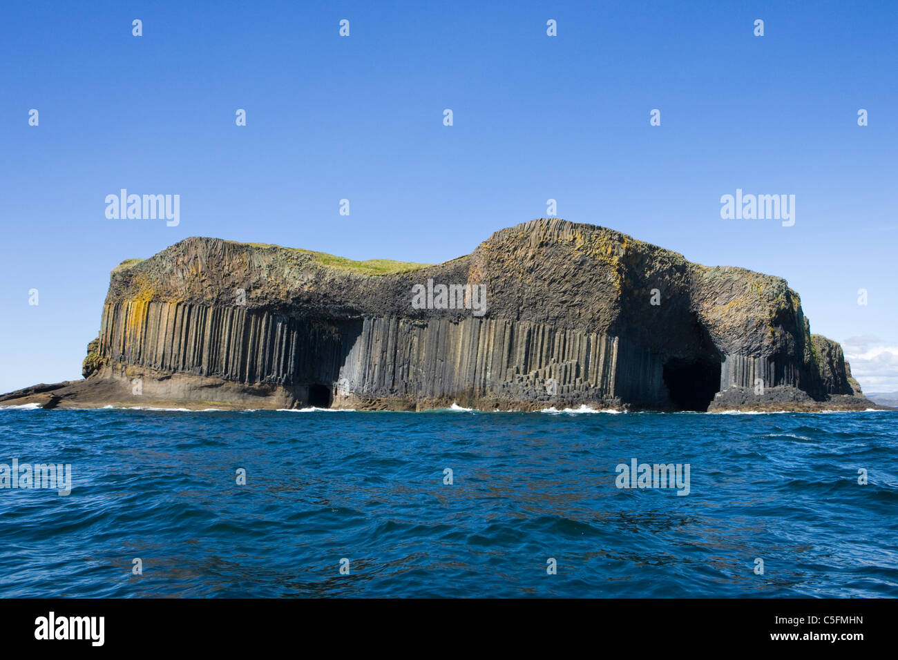 Staffa, Fingal's Cave on right, Boat Cave on left. Scotland, UK. - Stock Image