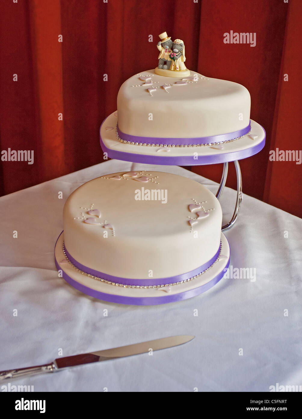 Cream And Purple Coloured Simple Two Tiered Wedding Cake With Bear