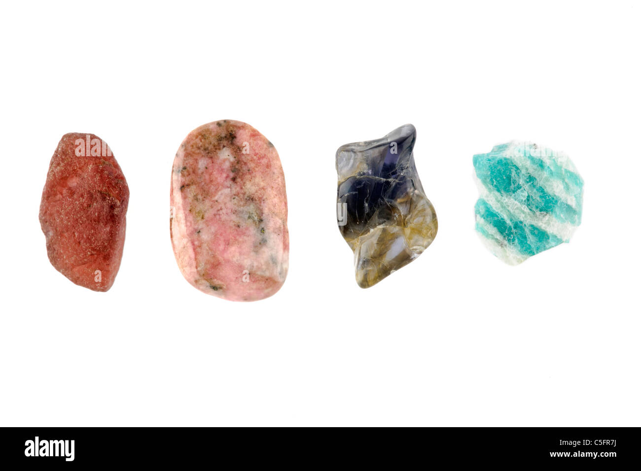 Four rock specimens all from Madagascar from left to right   Almandine, Rhodonite, Cordierite and Amazonite - Stock Image