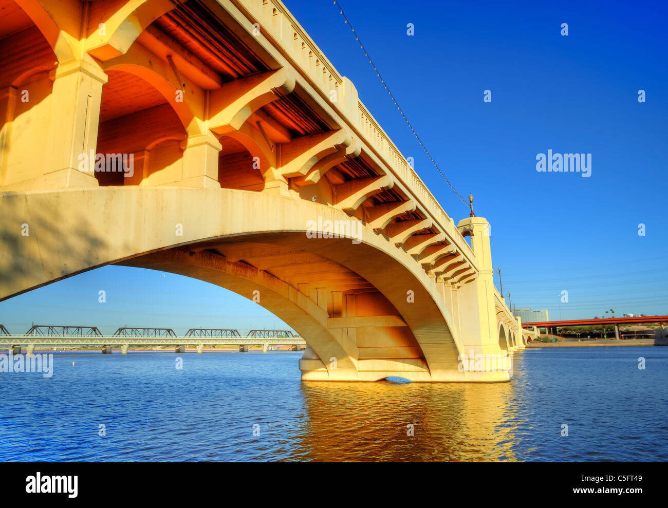 The Mill Avenue Bridges consist of two bridges that cross the Salt River in Tempe, AZ at the north end of the shopping - Stock Image