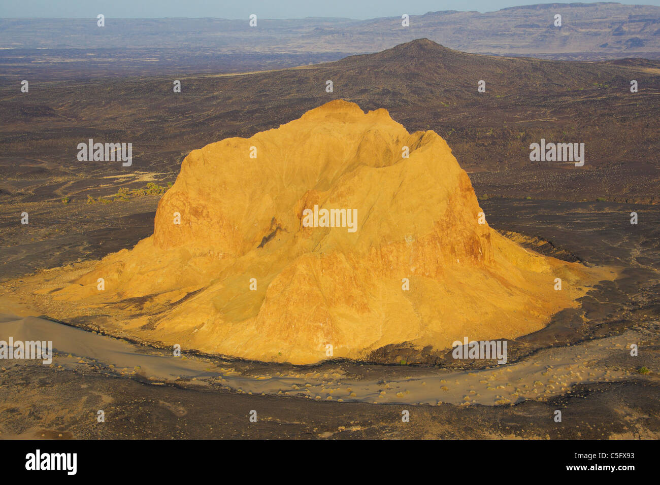 A crumbling extinct volcano, which is known as Aruba Rock Stock Photo