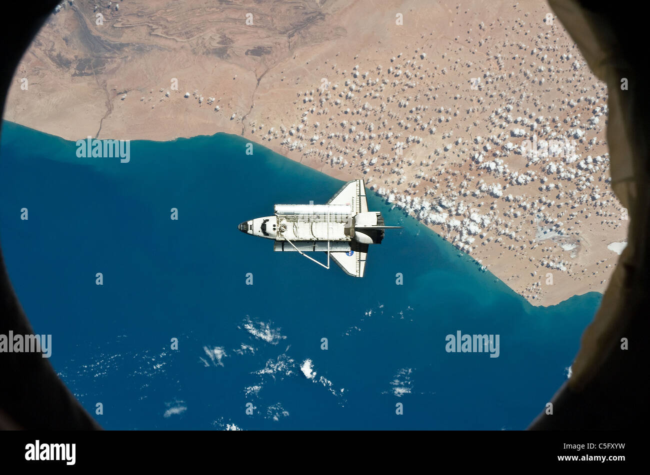 Space shuttle Discovery as seen from the International Space Station above southwestern coast of Morocco March 7 - Stock Image