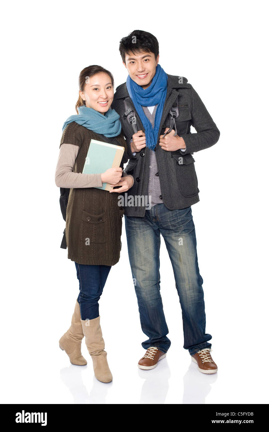 Two classmates smiling, white background - Stock Image