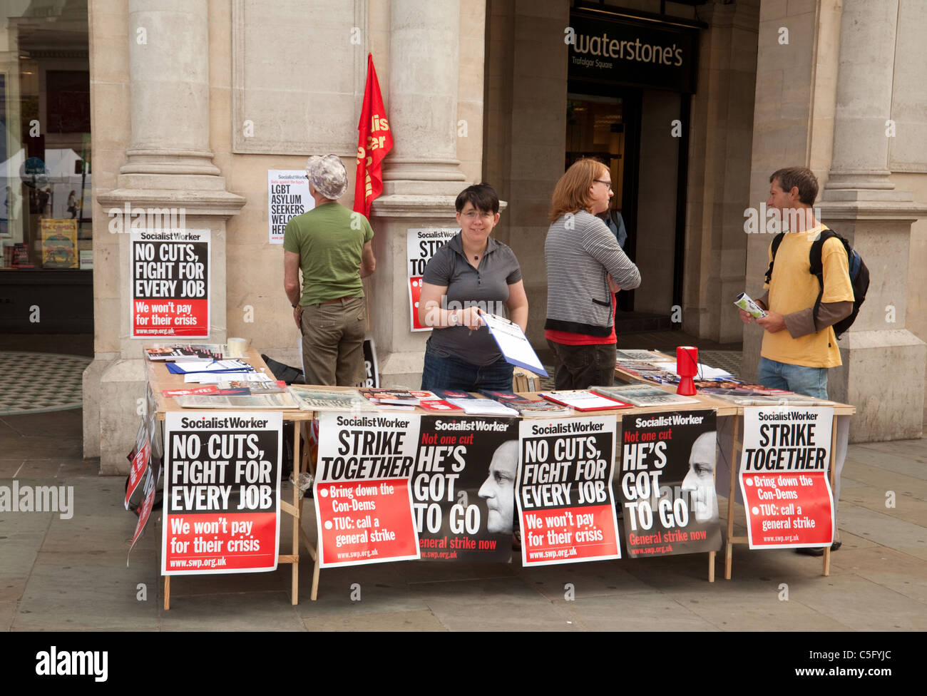 Socialist Worker Newspaper stall, Trafalgar square London UK - Stock Image