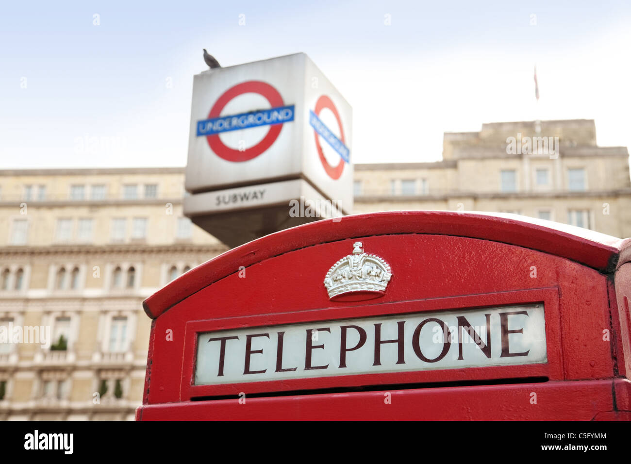 Red telephone box outside Charing Cross station, London UK - Stock Image