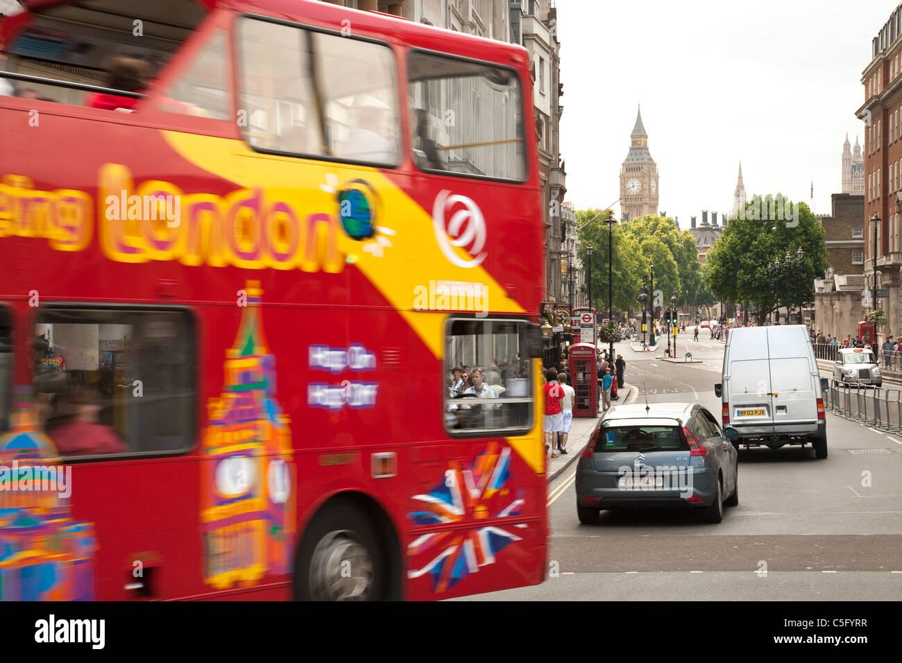 Red L:ondon double decker tour bus, Whitehall, London UK - Stock Image