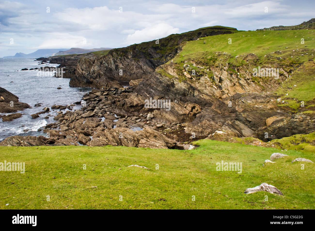 Atlantic seacoast cliffs and rocks on Achill Island off the west coast of Ireland - Stock Image