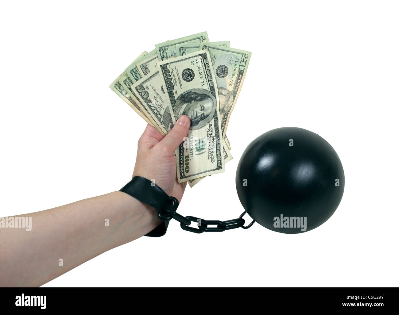 Money Issues shown by a model holding a large amount of cash while bound by a ball and chain - path included - Stock Image