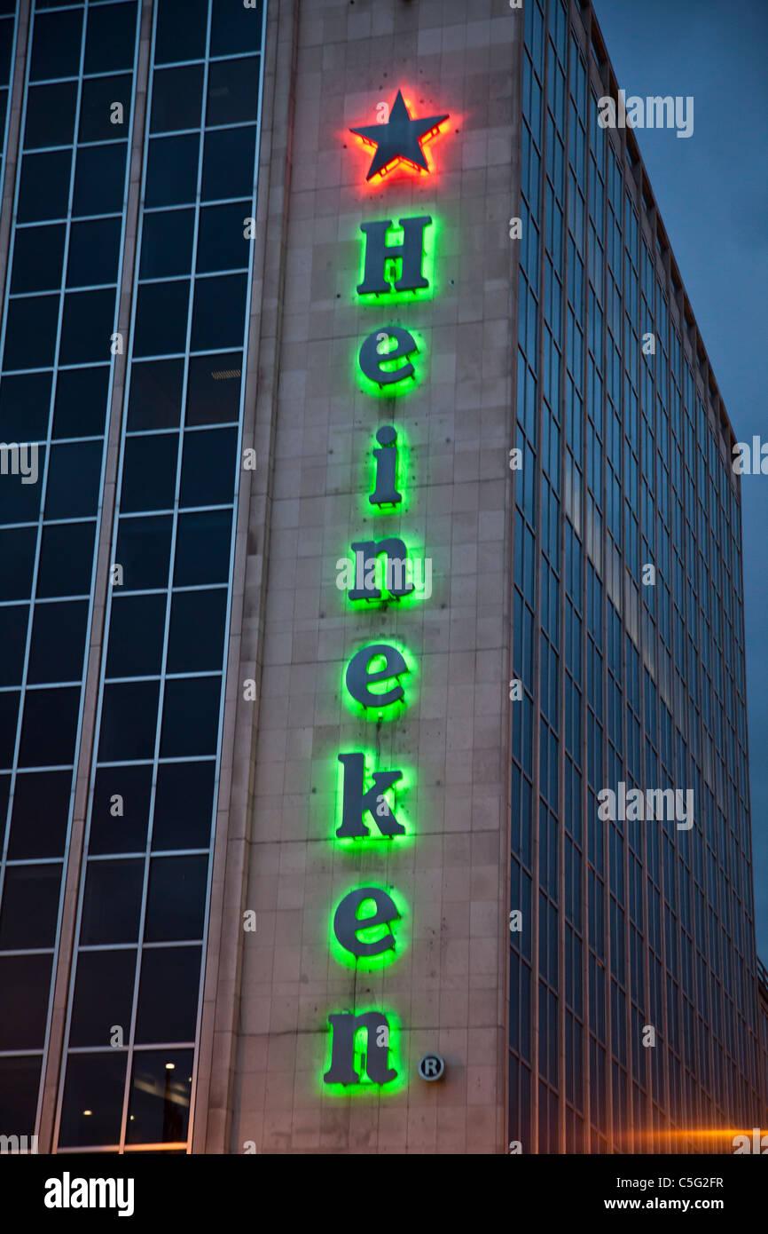 Illuminated Heineken advertisement on the O'Connell Bridge House, a 1960s modernist building in Dublin, Republic - Stock Image