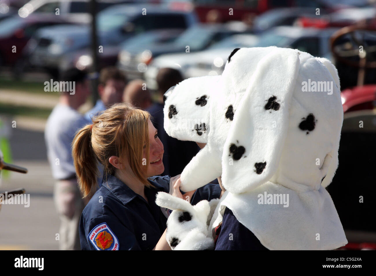 A Young Lady Looking Into The Mouth Of Sparky Fire Department Mascot