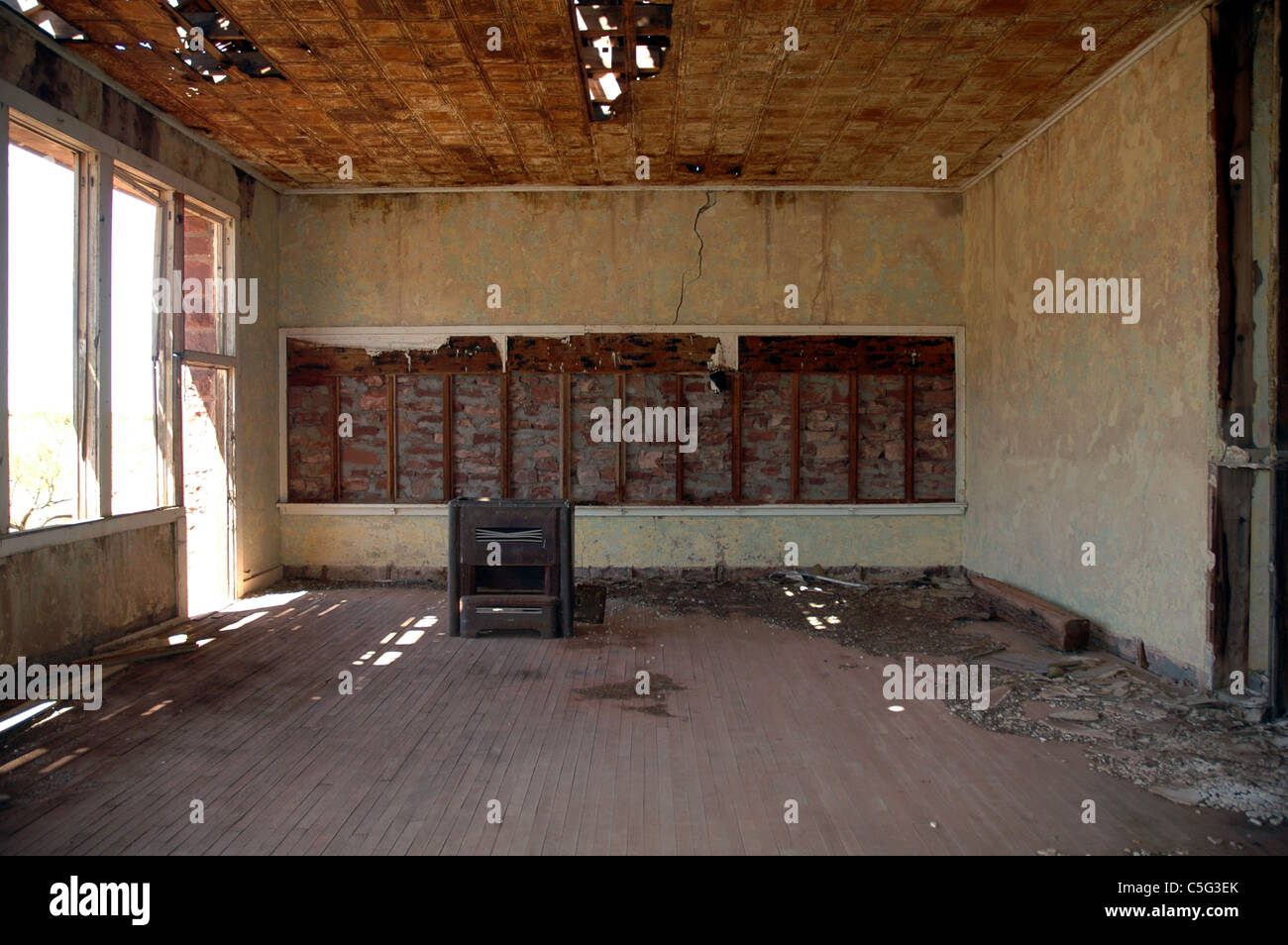 An old stove is the only remaining relic of an abandoned school house in Cuervo, New Mexico. - Stock Image