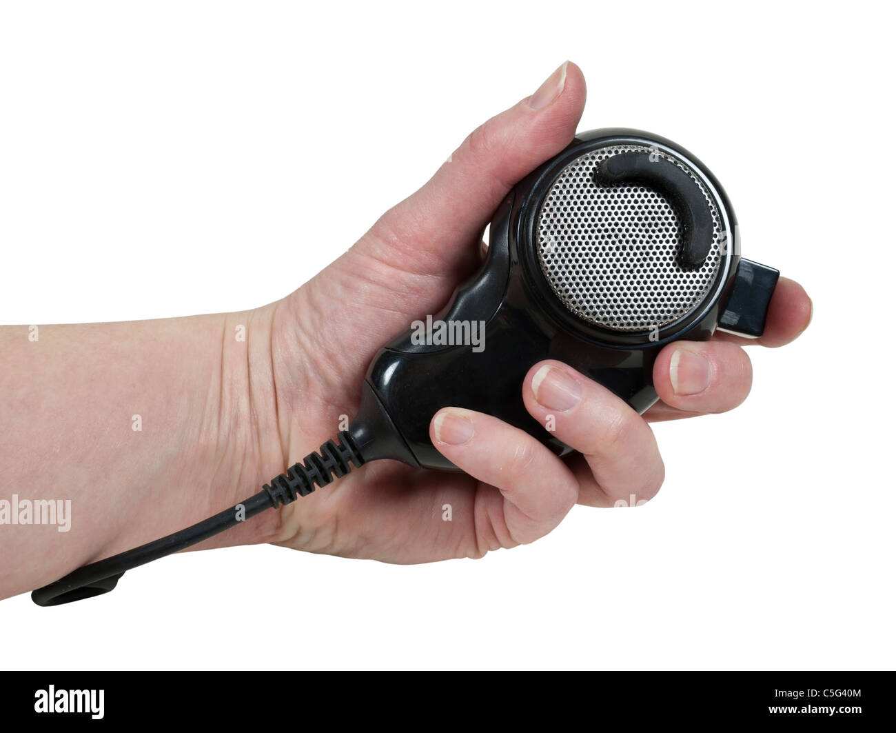 Holding a handheld microphone used to communicate via citizen band radio - path included Stock Photo