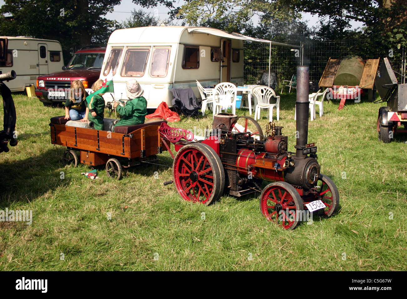 Children playing on miniature Foster traction engine built 1994 and seen at the 2006 YesterYear Rally Malpas Cheshire - Stock Image