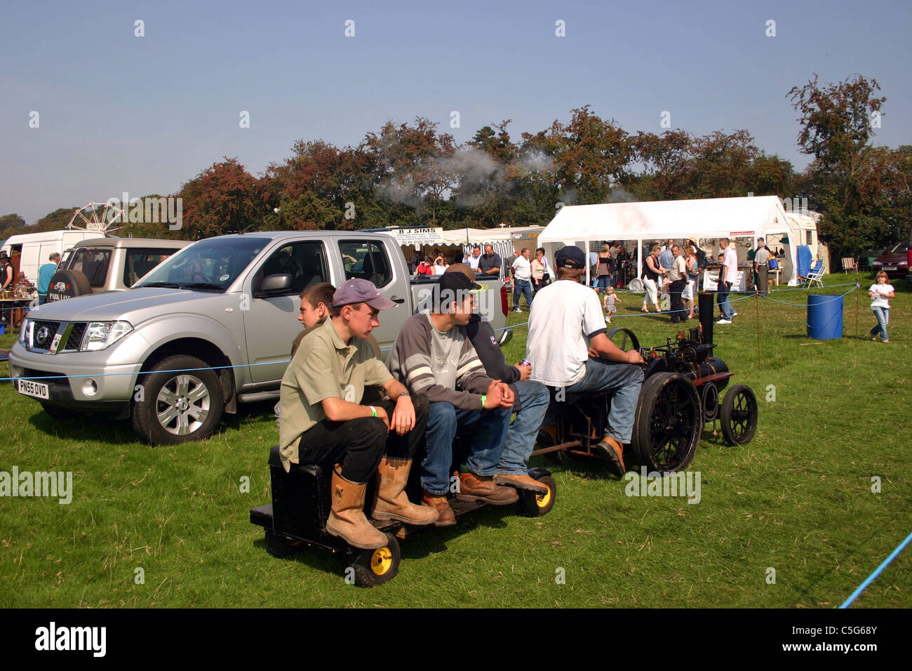 Scale traction engine and passengers going round the ground at YesterYear Rally2006  Malpas Cheshire England Stock Photo