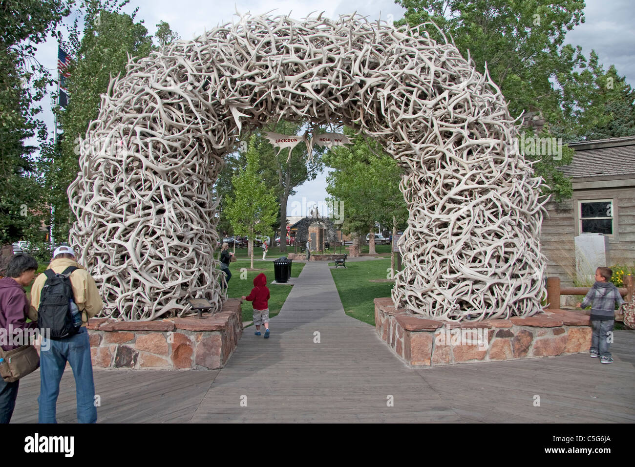 A young child exploring Jackson Hole's unusual Antler Gate. Stock Photo