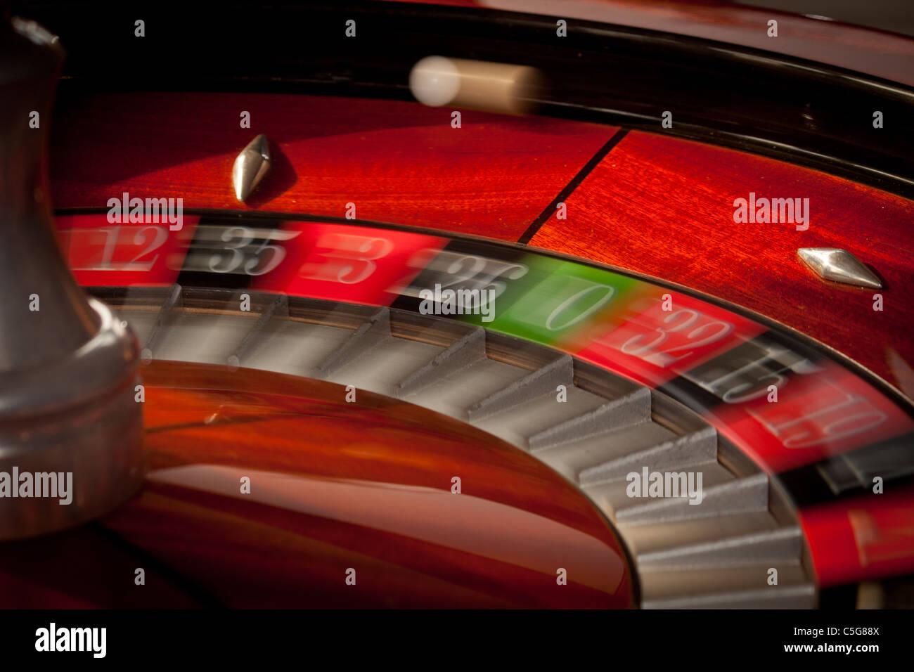 European casino roulette wheel ball in play motion blur - Stock Image