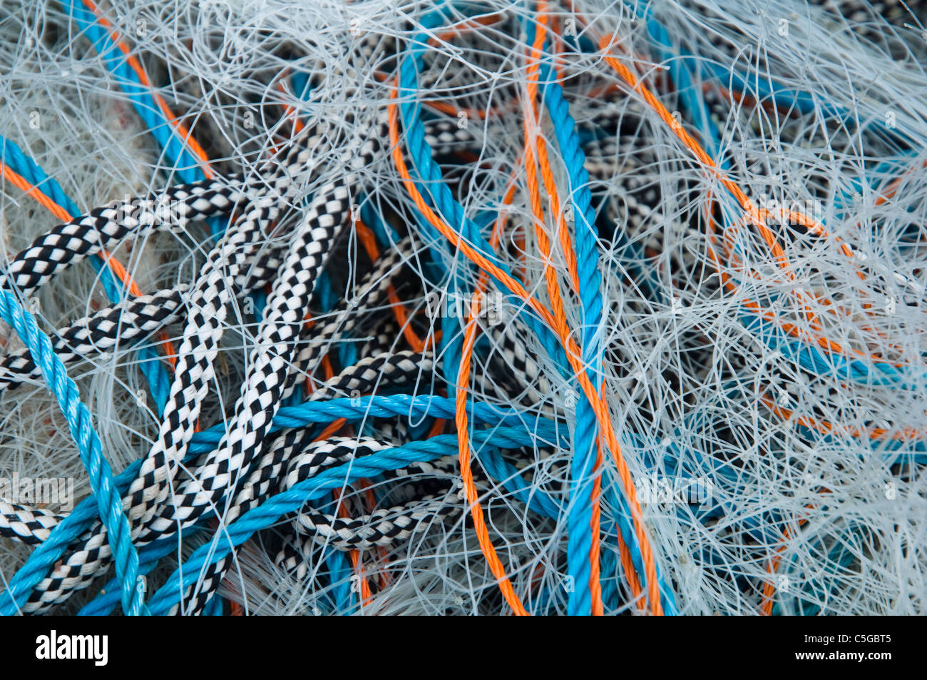 All tangled up - in a tangle - colourful abstract of  fishermans / fishing nets and ropes / lines. UK - Stock Image
