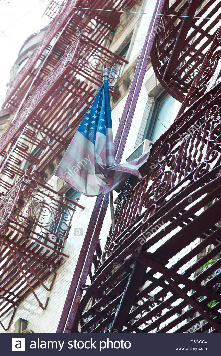 Battered decaying American Flag on a staircase in Little Italy in Manhattan in New York - Stock Image