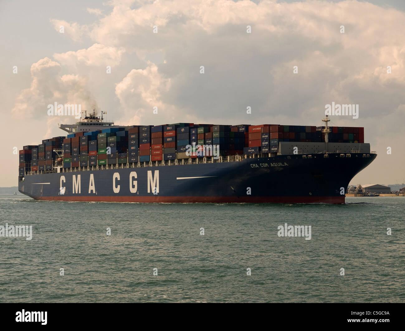 Container ship CMA CGM Aquila arriving at Southampton England UK - Stock Image