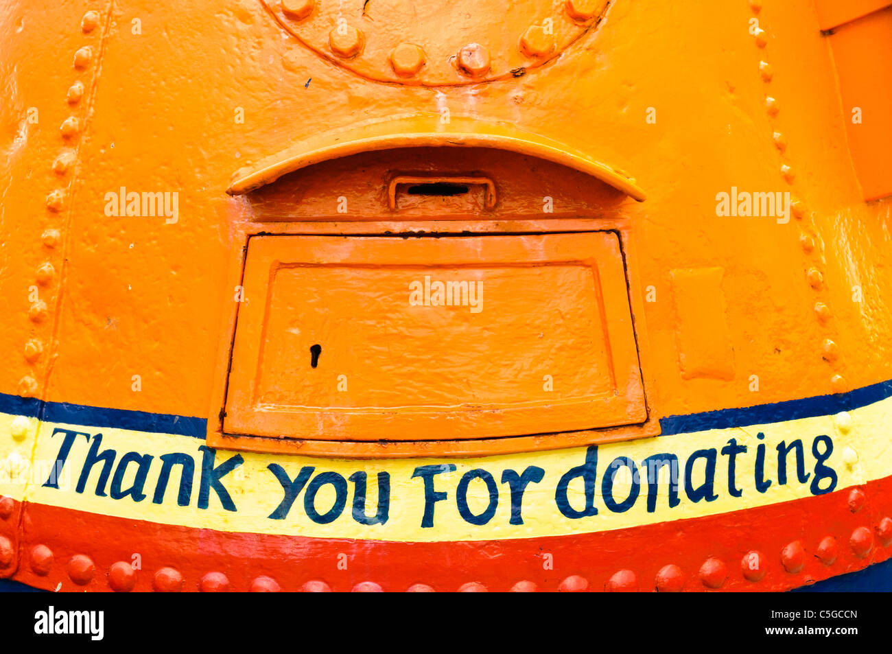 Marine buoy converted into a charity donation box for the RNLI with phrase 'Thank you for donating' - Stock Image