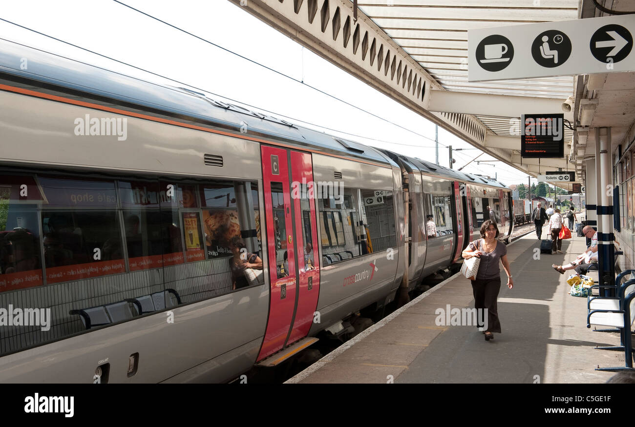 Passengers leaving a Crosscountry train having just arrived at a station in England. - Stock Image