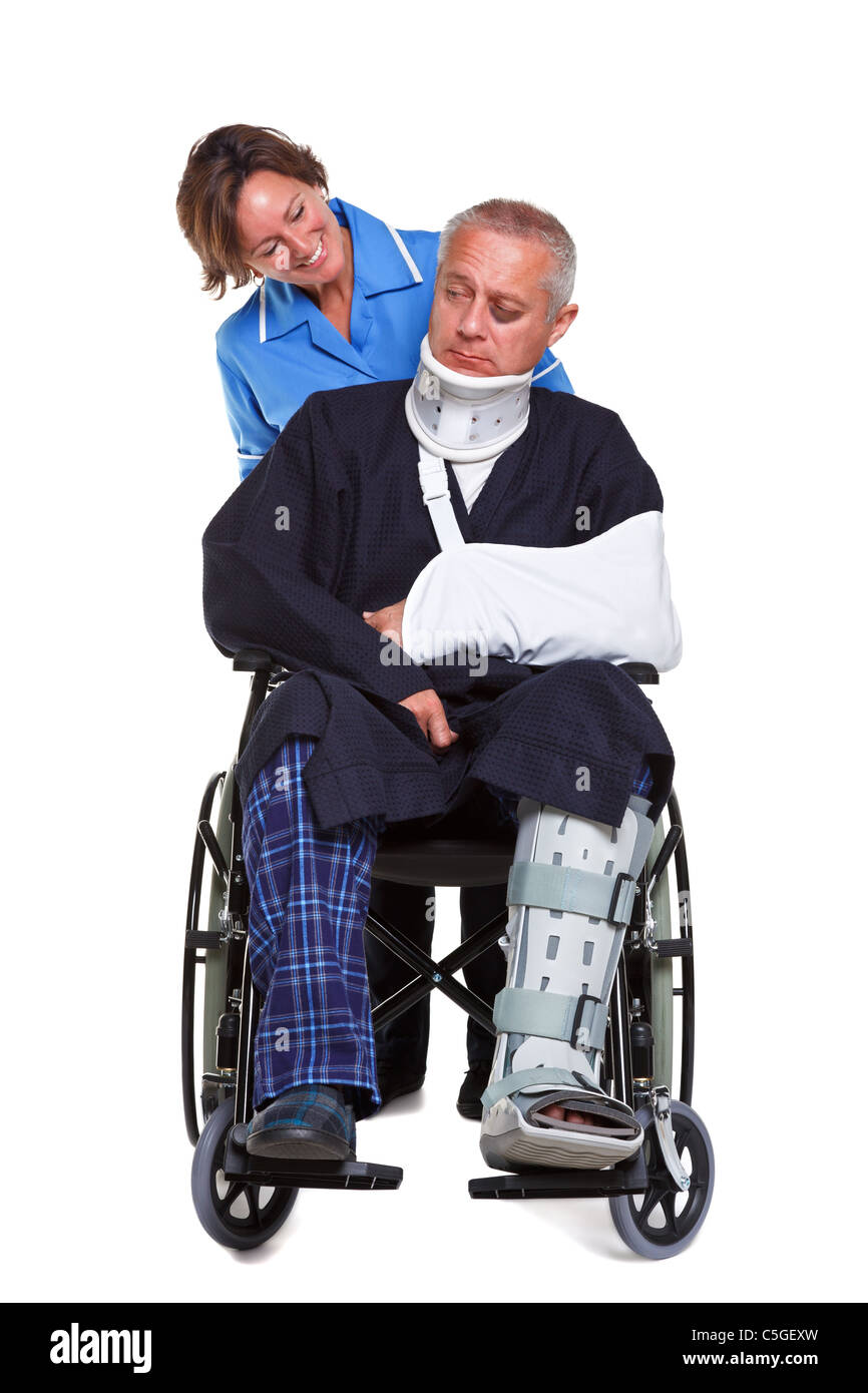 Photo of an injured man in a wheelchair with a female nurse pushing him, isolated on a white background. - Stock Image