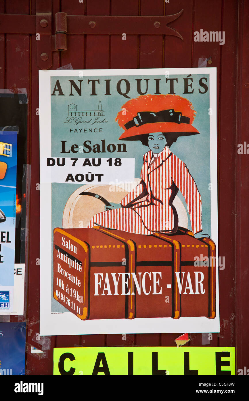 Old poster advertising antiques, Fayence, Provence, France - Stock Image
