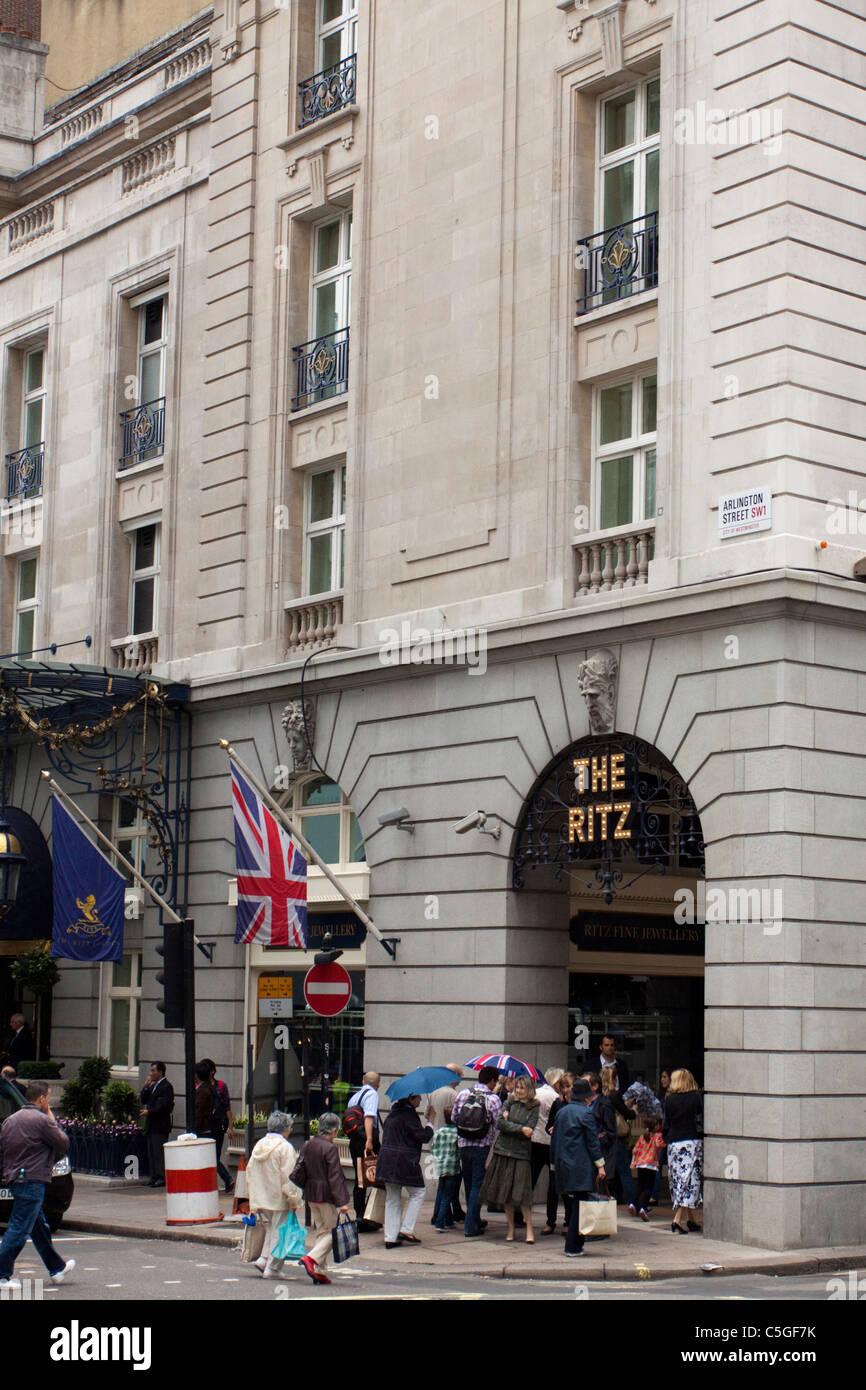 People walking past the Ritz Hotel, Piccadilly, London, England, UK - Stock Image