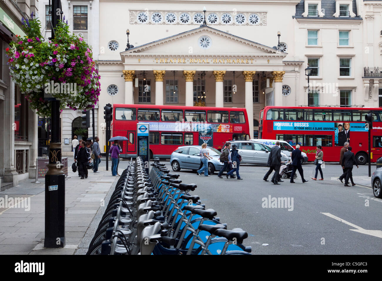 Theatre Royal Haymarket with Barclays rental bikes in the foreground, London, England, UK - Stock Image