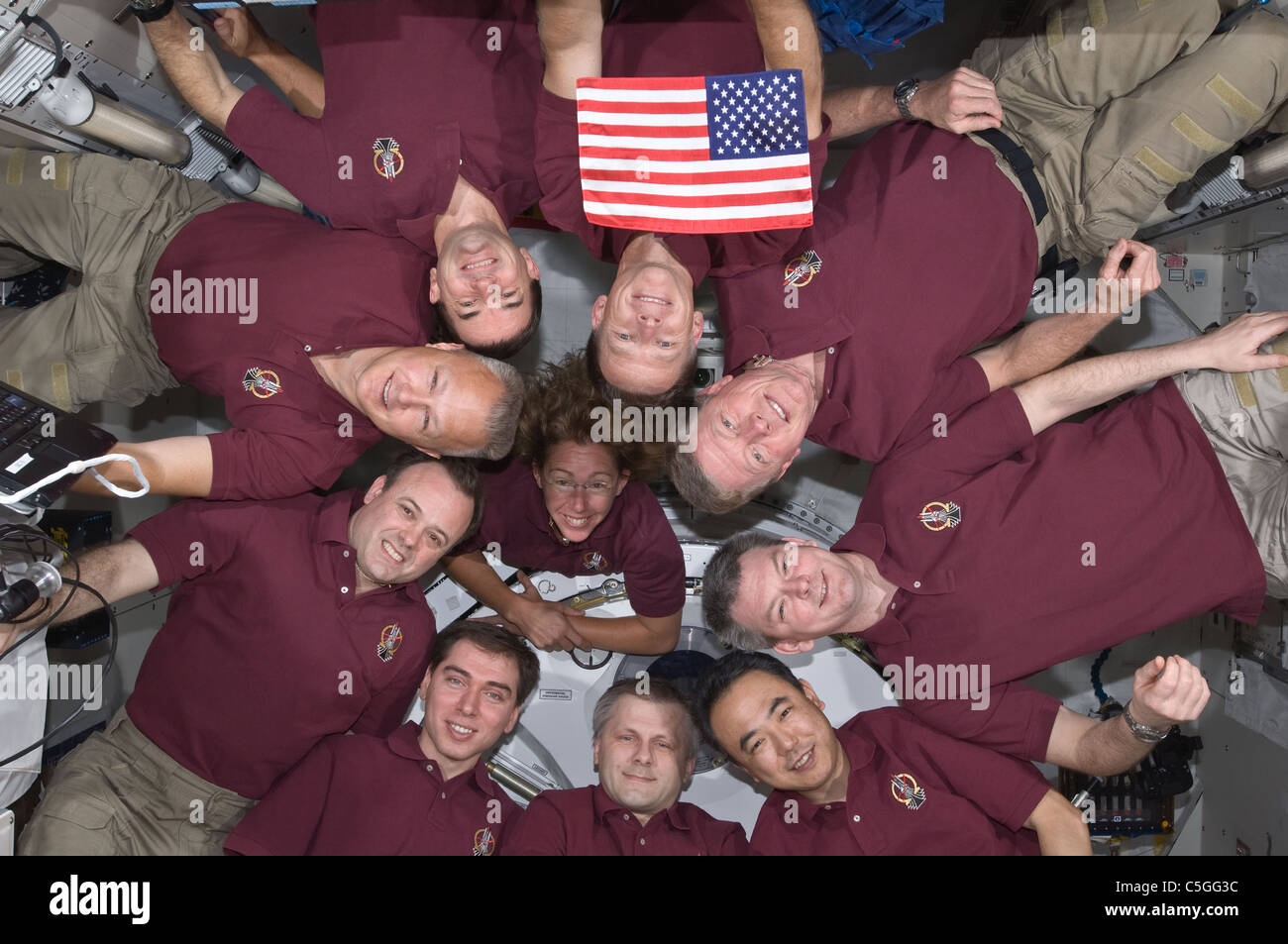 Atlantis space shuttle crew poses with the crew of the International Space Station on the final shuttle flight. - Stock Image