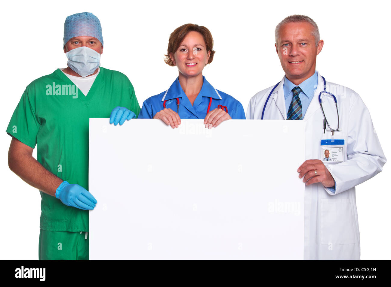 Photo of a medical team holding a blank poster for you to add your own message, isolated against a white background. - Stock Image