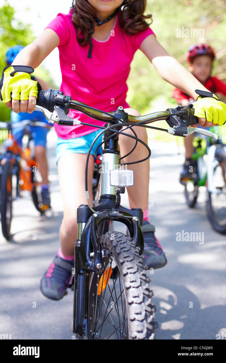 Close-up of children's bike ridden by a girl - Stock Image