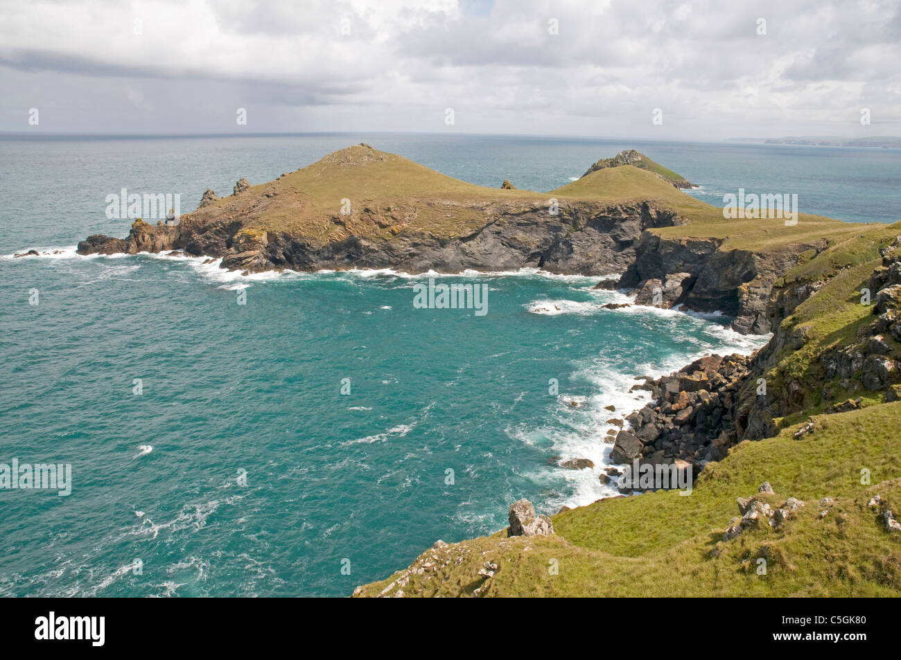Impressive stretch of Cornwall's Atlantic coastline, looking east to The Rumps from a promontory near Pentire - Stock Image