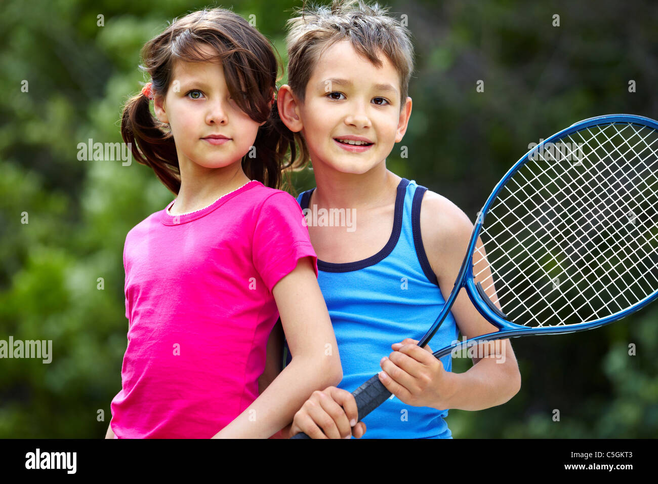 Portrait of a little girl and boy with badminton racket Stock Photo