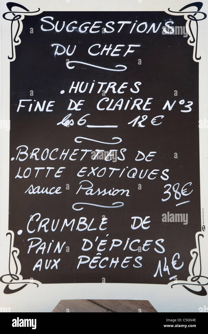 Blackboard with restaurant menu written in chalk on it, Provence, France - Stock Image