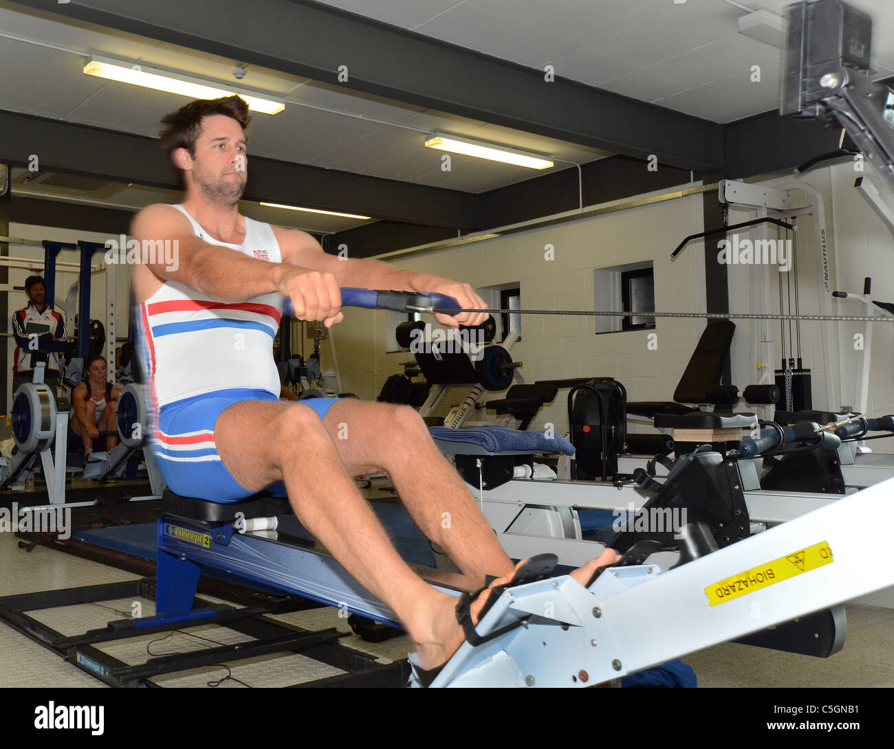Tom James,GBR rowing team, training on a rowing machine in gymnasium at the Redgrave Pinsent Rowing Lake and Sherriff - Stock Image
