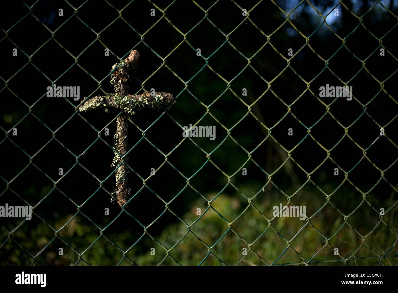 A hand made cross decorates a wire fence in the French Way of St. James Way, Galicia, Spain - Stock Image