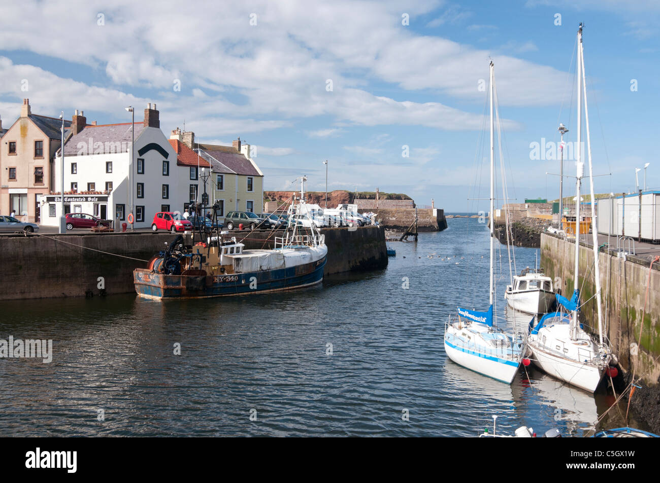 Eyemouth Harbour and sailing boats - Stock Image
