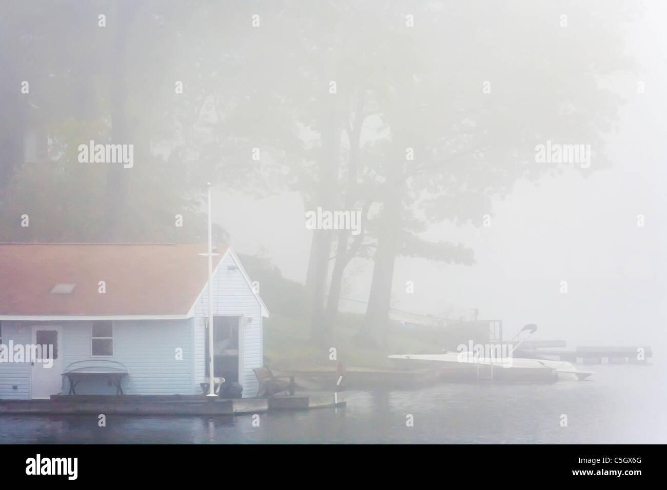 Heavy Fog on a lake. - Stock Image