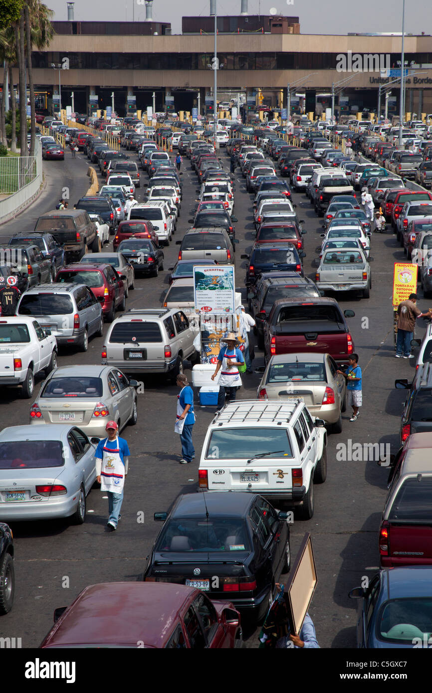 Tijuana, Mexico - Cars wait in long lines to cross the U.S.-Mexico border into California. - Stock Image