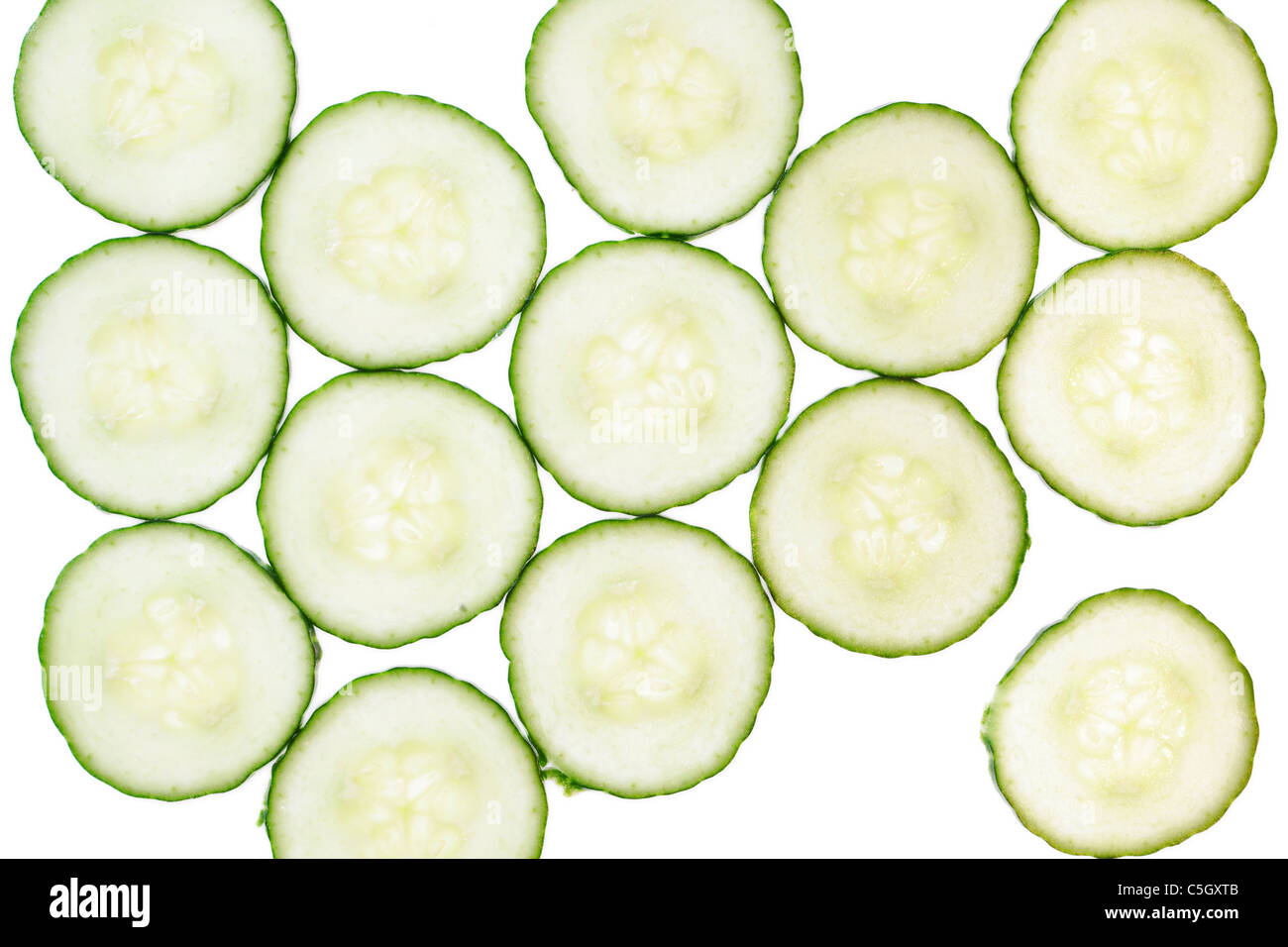 Pattern of fresh cucumber slices , isolated on a white background. - Stock Image