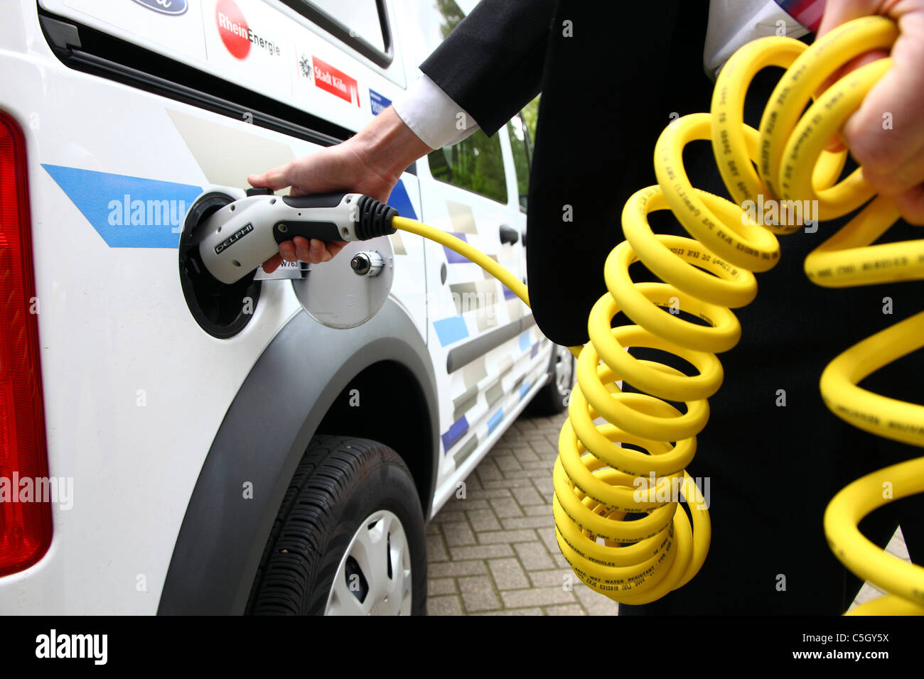 Electric vehicle, van. Powered by electricity. Charging the batteries. - Stock Image