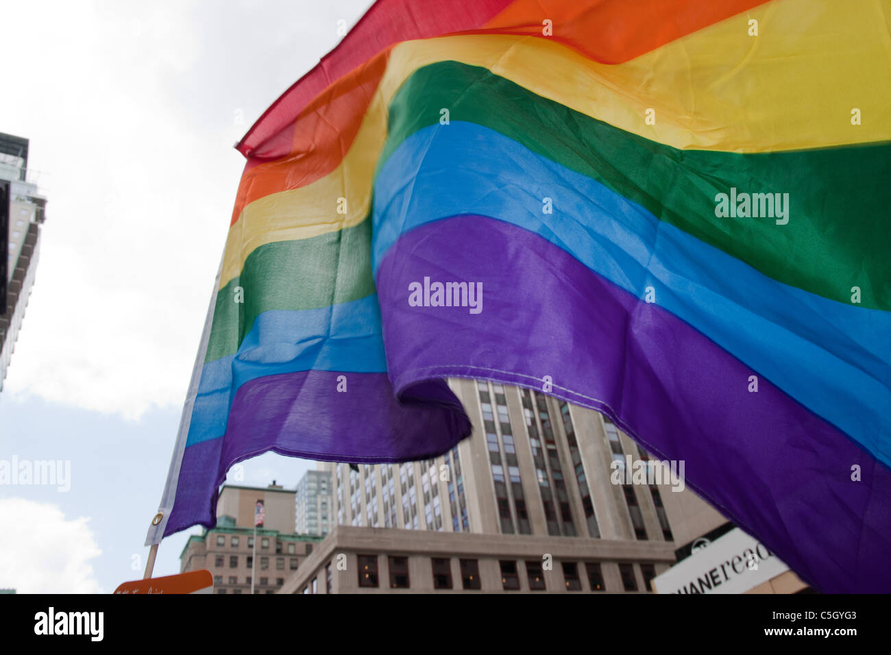 The gay pride rainbow flag flies under the Empire State building during the Gay Pride Parade in New York City. Stock Photo