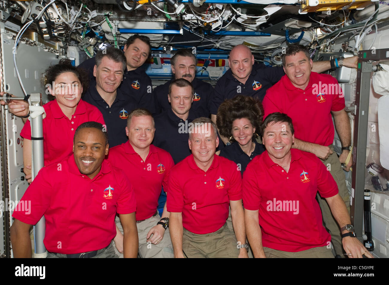Inside the U.S. lab Destiny 12 astronauts in group portrait aboard International Space Station Mission STS 133 March - Stock Image