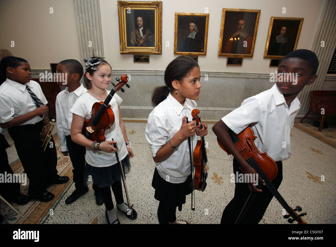Inner-city Middle school music students ready for a performance of classical music - Stock Image