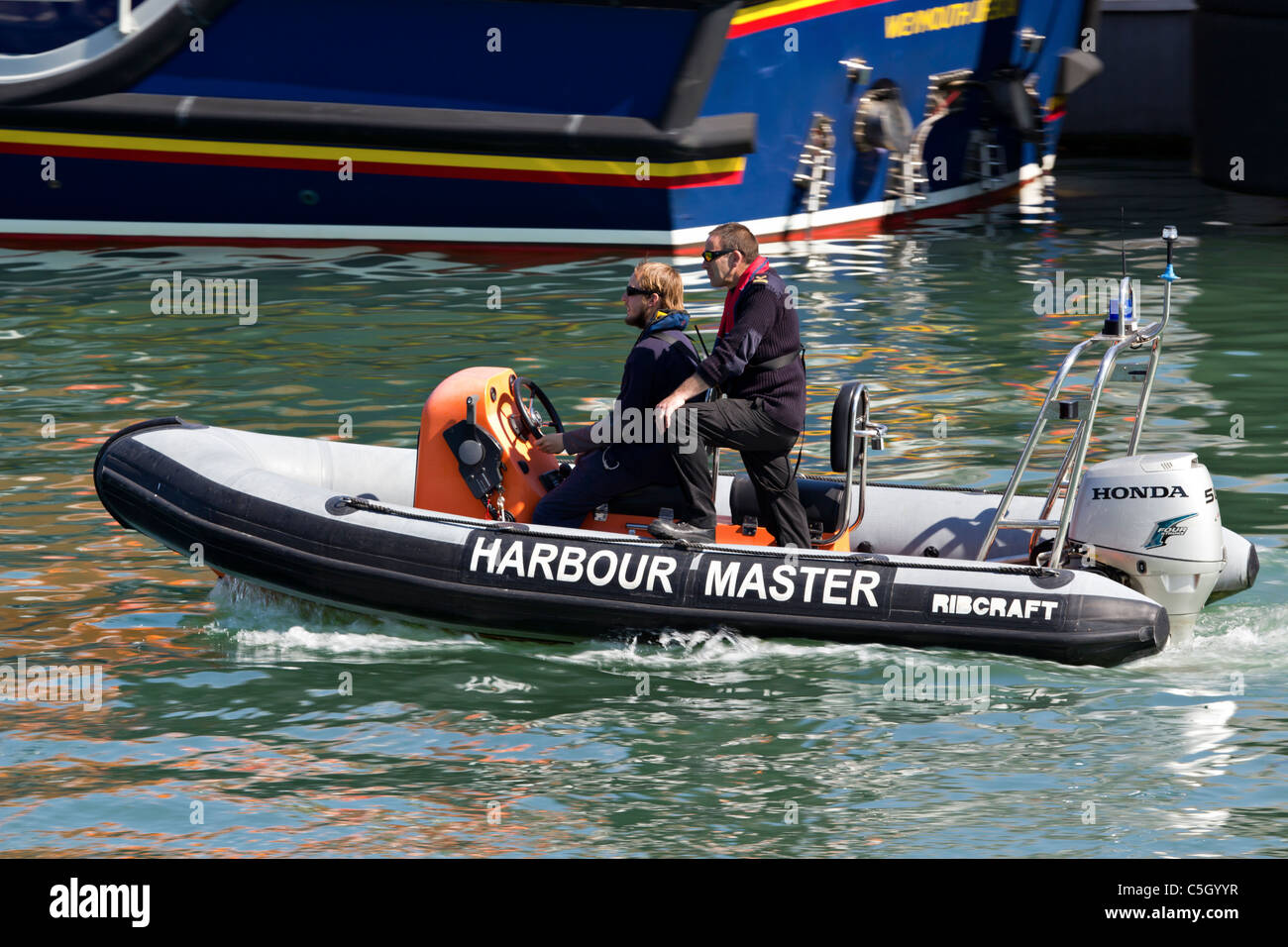 Harbour (harbor) master / harbourmaster / harbormaster ribcraft rib outboard powered boat in harbour - Stock Image